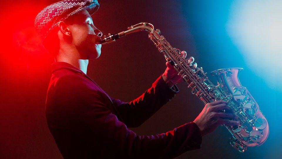 man blowing saxophone